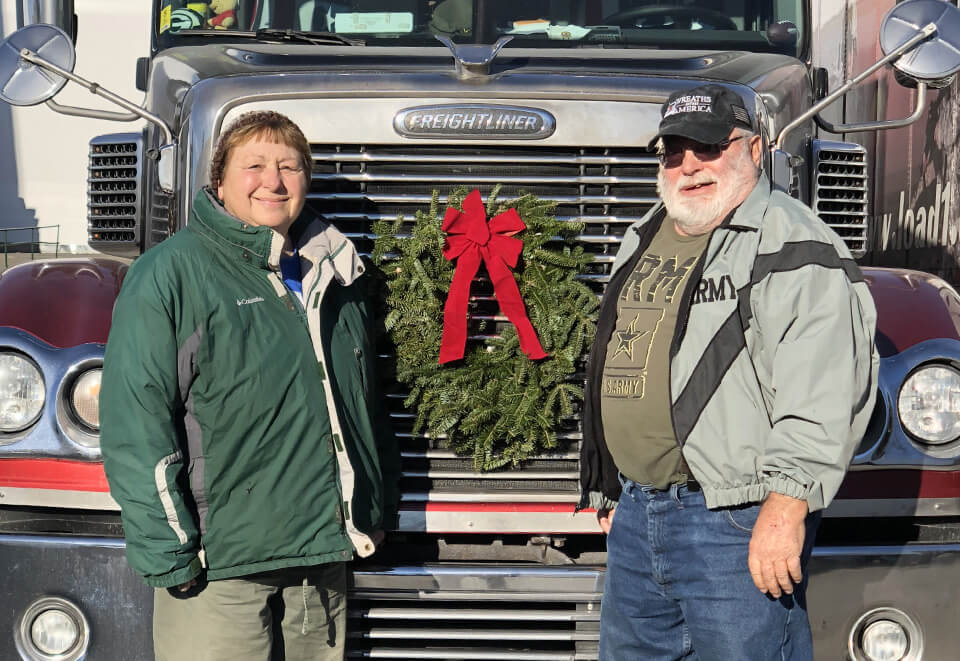 Wreaths across America Truck Grille, Driver couple